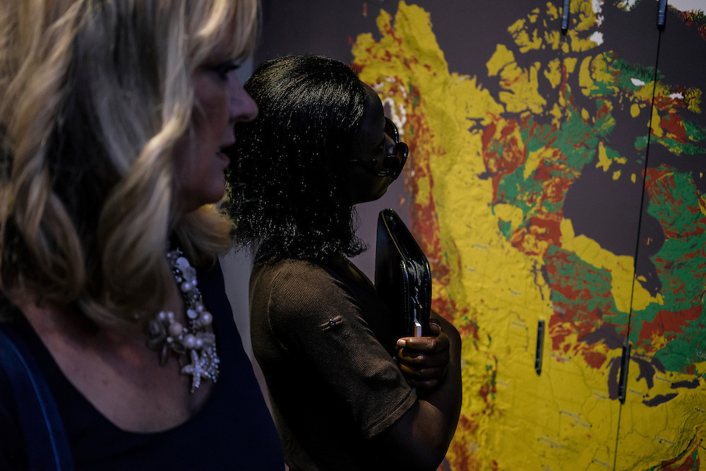 Lily, who escaped from Boko Haram during the kidnapping of almost 300 girls in Nigeria, tours the geology exhibits of the National Museum of Natural History in Washington, D.C. with Deanna Gelak, human development expert. Lily and other girls who escaped, are going through a summer of english and enrichment programs to help them discover their interests for future careers.