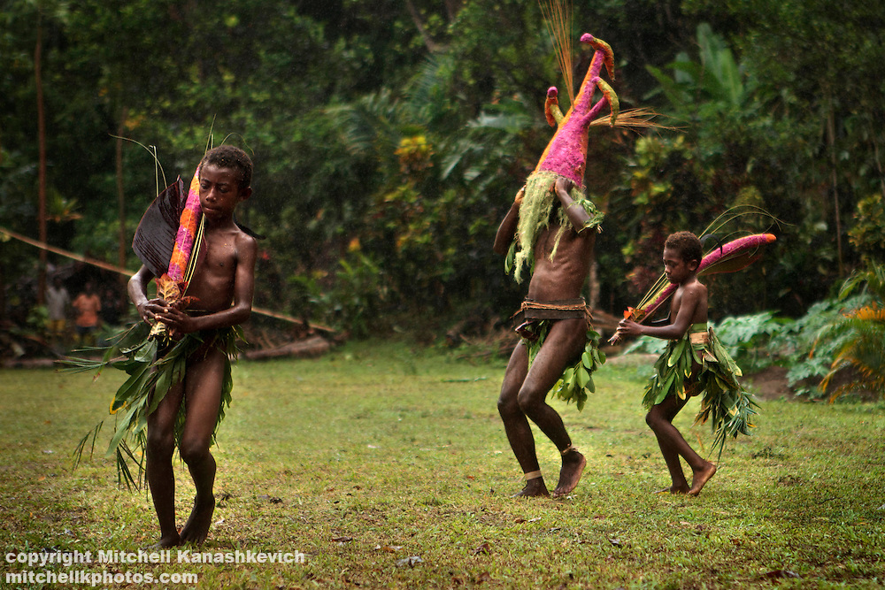 Performers with masks at Nalawan Festival near village of Labo, South West Bay, Malekula.