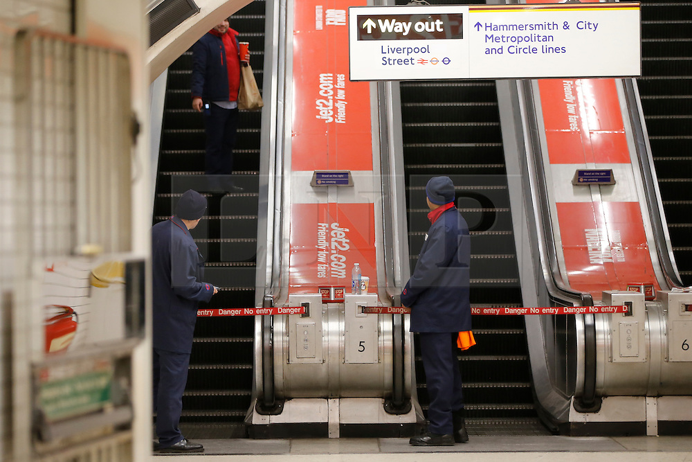 © Licensed to London News Pictures. 08/01/2017. London, UK. A tube worker leaves work whilst other TfL staff watching him go at Liverpool Street tube station as London Underground services are severely disrupted due to members of RMT and TSSA unions' 24 hour strike action in a dispute over jobs cuts and closed ticket offices on Sunday, 8 January 2017. The strike action also will be effective all day on Monday, 9 January 2017. Photo credit: Tolga Akmen/LNP