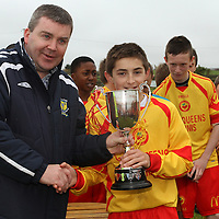 Ronnie Pyne (CSSL Chairman) presents the U13 Cup to Avenue United Captain Tadhg Connellan.<br /> Photograph by Flann Howard