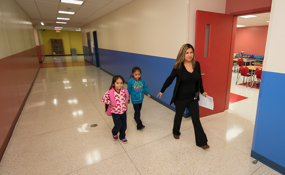 Students are led to class on Monday in the new Sherman Elementary School.