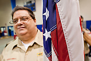 """July 2 - PHOENIX, AZ: Boy Scout leaders carry the American flag at the beginning of a naturalization ceremony in Phoenix Friday. Nearly 200 people were sworn in as US citizens during the """"Fiesta of Independence"""" at South Mountain Community College in Phoenix, AZ, Friday. The ceremony is an annual event on th 4th of July weekend and usually the largest naturalization ceremony of the year in the Phoenix area.  Photo by Jack Kurtz"""