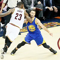 10 June 2016: Cleveland Cavaliers forward LeBron James (23) drives past Golden State Warriors guard Stephen Curry (30) during the Golden State Warriors 108-97 victory over the Cleveland Cavaliers, during Game Four of the 2016 NBA Finals at the Quicken Loans Arena, Cleveland, Ohio, USA.