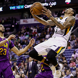 Feb 8, 2017; New Orleans, LA, USA; Utah Jazz guard George Hill (3) shoots as New Orleans Pelicans guard Tim Frazier (2) and forward Anthony Davis (23) defend during the second half of a game at the Smoothie King Center. The Jazz defeated the Pelicans 127-94.  Mandatory Credit: Derick E. Hingle-USA TODAY Sports