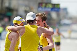2013 Boston Marathon: BAA teammates celebrate together after finishing: Ryan McCalmon, Peter Gilmore,  Ian Nurse,