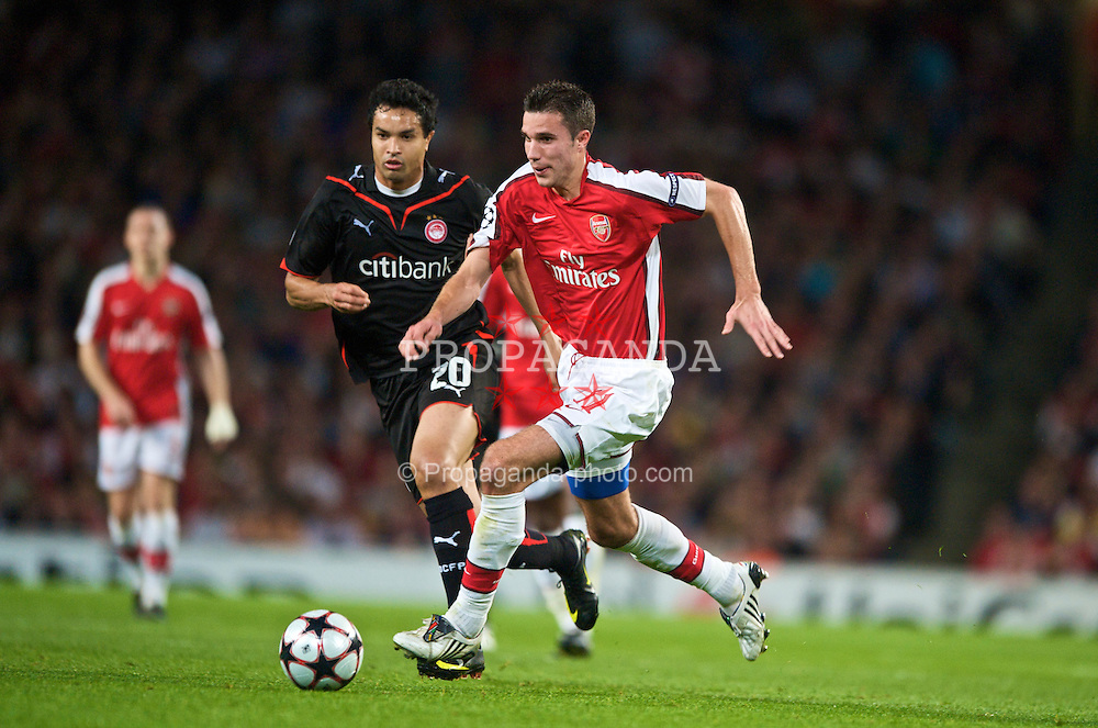 LONDON, ENGLAND - TUESDAY, SEPTEMBER 29th, 2009: Arsenal's Robin Van Persie and Olympiakos' Dudu during the UEFA Champions League Group H match at the Emirates Stadium. (Photo by Chris Brunskill/Propaganda)