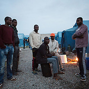 Migrants from Gambia, Mali,  Sudan and Congo at the Tendopoli di Rosarno. Migrants, who are searching for jobs, live in this type of settlement provided by the Government. Between seven and eight people share the tents, without any access to running water and toilet facilities. Living conditions are terrible in these camps.
