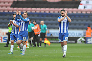 Wigan player  applaud there fans after they win 4-1 in the Sky Bet League 1 match between Wigan Athletic and Southend United at the DW Stadium, Wigan, England on 23 April 2016. Photo by John Marfleet.