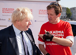 © Licensed to London News Pictures. LONDON, UK  05/07/11. Mayor of London, Boris Johnson, talks to former Labour spin doctor, Alastair Campbell, at a press call in Trafalgar Square today (Tuesday). Please see special instructions for usage rates. Photo credit should read Matt Cetti-Roberts/LNP