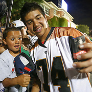 Miles Thompson #74 of the Rochester Rattlers takes a selfie with a fan following the game at Harvard Stadium on August 9, 2014 in Boston, Massachusetts. (Photo by Elan Kawesch)