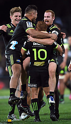 Hurricanes Ihaia West, centre, is swamped by team mates after kicking the last minute conversion to defeat the Sharks 38-37 in the Super Rugby match at McLean Park, Napier, New Zealand, Friday, April 06, 2018. Credit:SNPA / Ross Setford