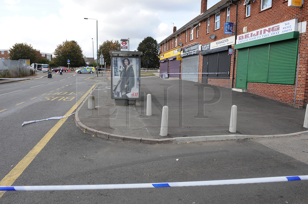 © Licensed to London News Pictures. 01/10/2014<br /> A man has been left with head injuries after an assault in Slade Green,Greater London. Kent border,near Erith. <br /> Police have cordoned off Bridge Road where it meets Northend Road following the incident, which happened at around 10pm last night (September 30). <br /> Weapons are believed to have been involved. <br /> A 17-year-old man was arrested on suspicion of GBH and is currently in custody. <br /> Another suspect later handed themselves in to police. <br /> (Byline:Grant Falvey/LNP)