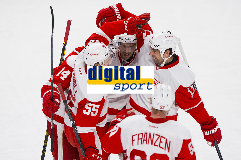 05 April 2014: Niklas Kronwall 55 of the Detroit Red Wings celebrates his goal with teammates during the NHL Eishockey Herren USA match against the Montreal Canadiens at the Bell Centre in Montreal Quebec, Canada. The Canadiens defeat the Red Wings 5-3. NHL Eishockey Herren USA APR 05 Red Wings at Canadiens <br /> <br /> Norway only