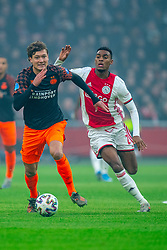Sam Lammers #14 of PSV Eindhoven and Ryan Gravenberch #29 of Ajax in action during the match between Ajax and PSV at Johan Cruyff Arena on February 02, 2020 in Amsterdam, Netherlands