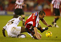 Photo: Aidan Ellis.<br /> Sheffield Utd v Luton Town. Coca Cola Championship.<br /> 01/11/2005.<br /> Sheffield's Neil Shipperly is brought down by Luton's Leon Barnett