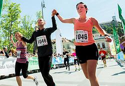 Runners at finish line during running race 12 km and 29 km Tek trojk et event Pot ob zici, on May 10, 2014, at Kongresni trg in Ljubljana, Slovenia. Photo by Vid Ponikvar / Sportida