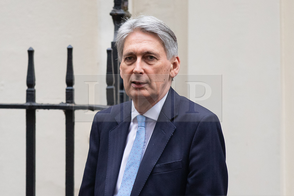 © Licensed to London News Pictures. 16/01/2019. London, UK. Chancellor of the Exchequer Philip Hammond leaves 11 Downing Street to attend Prime Minister's Questions. Last night, Corbyn tabled a motion of no confidence in British Prime Minister Theresa May, following the worst government defeat on record of 230 votes on her EU withdrawal deal. Photo credit : Tom Nicholson/LNP