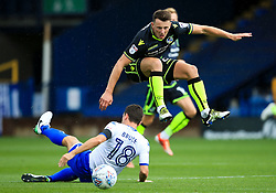 Ollie Clarke of Bristol Rovers hurdles a challenge from Alex Bruce of Bury - Mandatory by-line: Matt McNulty/JMP - 19/08/2017 - FOOTBALL - Gigg Lane - Bury, England - Bury v Bristol Rovers - Sky Bet League One