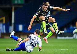 Ollie Clarke of Bristol Rovers hurdles a challenge from Alex Bruce of Bury - Mandatory by-line: Matt McNulty/JMP - 19/08/2017 - FOOTBALL - Gigg Lane - Bury, England - Bury v Bristol Rovers - Sky Bet League One