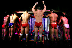 Male strippers perform, Saturday, August 12, 2006 in New York.