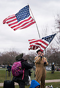 Russ Bennett flies an American flag before  a rally for Democratic 2020 presidential candidate Bernie Sanders at James Madison Park in Madison, WI on Friday, April 12, 2019.