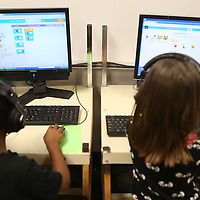 Lauren Wood | Buy at photos.djournal.com<br /> Aiden Ramos, left, and Meghan Crownover work on writing code on the classroom computers Tuesday during the Hour of Code in Ragen Lambert's first grade classroom at Carver Elementary School.