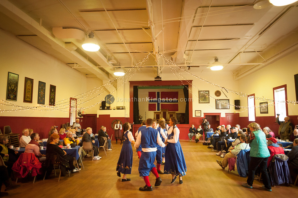 Tourists watch a troupe of teenage dancers perform a traditional Norwegian dance in he Sons of Norway lodge in Petersburg, Alaska.