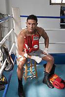 Man sitting in corner of boxing ring