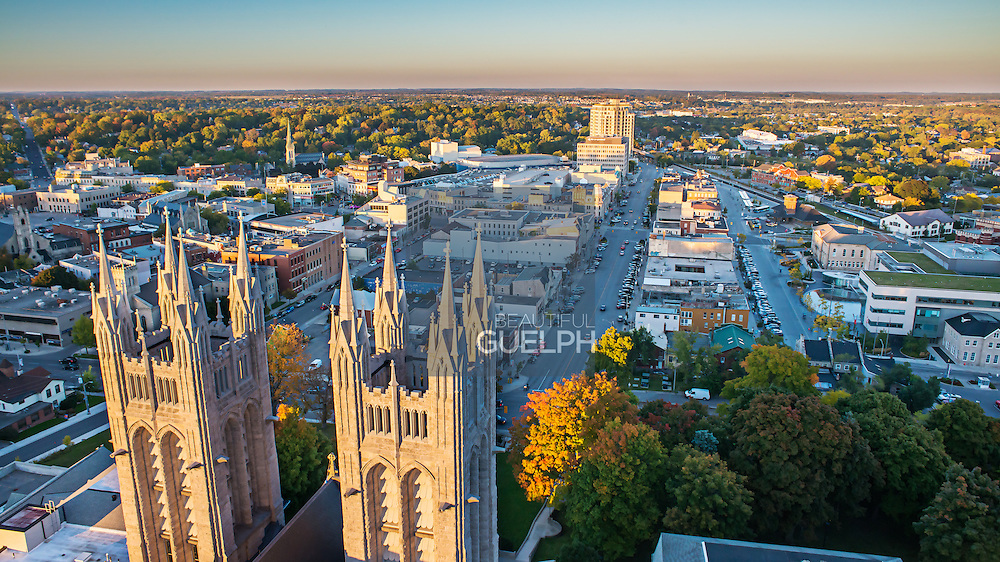 Church of Our lady in Guelph Ontario.  An aerial view using a drone from the behind the church.  Downtown Guelph is seen beautifully behind the churches 'sentinels'.  The photo was taken by Eye Fly Media Inc.  eyeflymedia.com