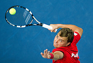 Marcin Matkowski of Poland competes at men's double game during second day of the BNP Paribas Davis Cup 2013 between Poland and South Africa at MOSiR Hall in Zielona Gora on April 06, 2013...Poland, Zielona Gora, April 06, 2013..Picture also available in RAW (NEF) or TIFF format on special request...For editorial use only. Any commercial or promotional use requires permission...Photo by © Adam Nurkiewicz / Mediasport