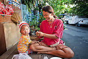 Sept. 23, 2009 -- BANGKOK, THAILAND: A feeds her son in the Khlong Toey slum in Bangkok. Khlong Toey slum in Bangkok, Thailand, is the largest slum area in Bangkok. Photo by Jack Kurtz
