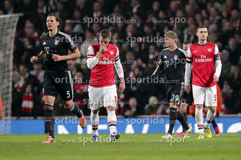 19.02.2013, Emirates Stadion, London, ENG, UEFA Champions League, FC Arsenal vs FC Bayern Muenchen, Achtelfinale Hinspiel, im Bild Lukas PODOLSKI (FC Arsenal London - 9) enttaeuscht, frustriert, Entaeuschung, Frust, Emotionen nach 0-2 Rueckstand // during the UEFA Champions League last sixteen first leg match between Arsenal FC and FC Bayern Munich at the Emirates Stadium, London, Great Britain on 2013/02/19. EXPA Pictures © 2013, PhotoCredit: EXPA/ Eibner/ Ben Majerus..***** ATTENTION - OUT OF GER *****