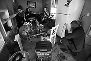 Jeremy Gibson, from left, Kimi Samson, Caleb Elliott, and Dylan LeBlanc set up for practice Monday in Florence. Gibson and Elliott recently moved from Louisiana to do studio work and back LeBlanc. Samson, who has lived here since 2002, plays violin in studio and for a variety of bands in the Shoals.