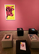 """V-A-C Foundation, The Explorers, Part One. Reading corner with publications about the exhibited artists. Andy Warhol, """"Cow"""", 1966."""