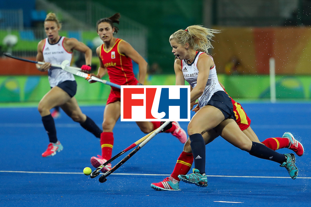 RIO DE JANEIRO, BRAZIL - AUGUST 15:  Sophie Bray #19 of Great Britain moves the ball against Spain during the first half of the quarter final hockey game on Day 10 of the Rio 2016 Olympic Games at the Olympic Hockey Centre on August 15, 2016 in Rio de Janeiro, Brazil.  (Photo by Christian Petersen/Getty Images)