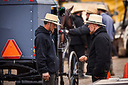 Amish men socialize during the Annual Mud Sale to support the Fire Department  in Gordonville, PA.