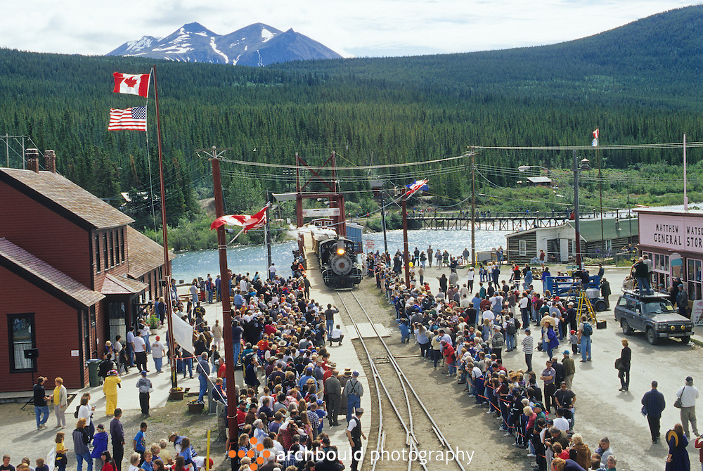 People gather to watch the Whitepass train arrive in the town of Carcross Yukon