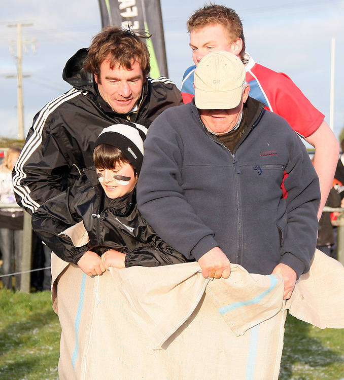 "Andrew Hore, left,  and team mates compete in a sack race as part of the ""All Blacks Coming to a Town Near You"" visit at Midlands Rugby Ground in Winton, New Zealand, Friday, September 02, 2011. Credit:SNPA / Dianne Manson."