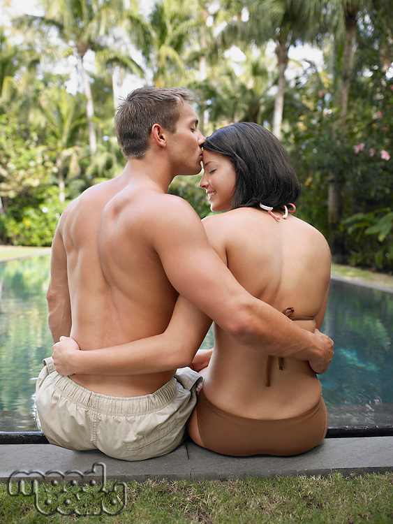 Young Couple Kissing at Swimming Pool
