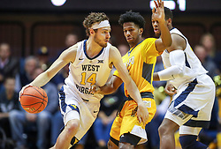 Nov 24, 2018; Morgantown, WV, USA; West Virginia Mountaineers guard Chase Harler (14) dribbles during the first half against the Valparaiso Crusaders at WVU Coliseum. Mandatory Credit: Ben Queen-USA TODAY Sports