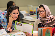 Teachers participate in a Week of the Young Child workshop, April 15, 2015.