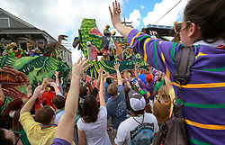 02 March 2014. New Orleans, Louisiana.<br /> Mardi Gras. Crowds shout for beads and trinkets from float riders at the  Krewe of Thoth parade in Uptown New Orleans.<br /> Photo; Charlie Varley/varleypix.com