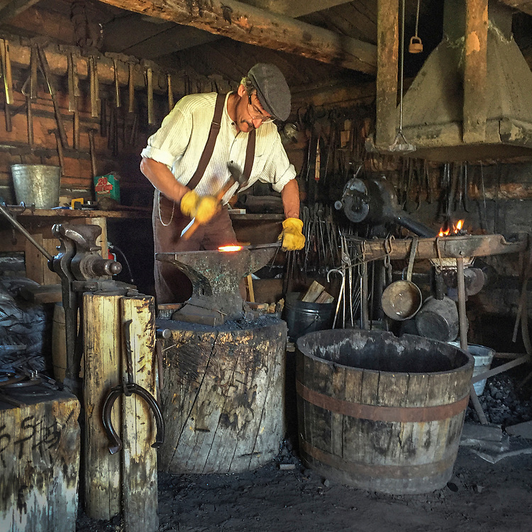 Volunteer Steve Marty in the blacksmith shop at the Tinsley homestead at Museum of the Rockies in Bozeman, Montana.