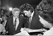 Bob Geldof Receives F.A.O.Medal..1986..16.10.1986..10.16.1986..16th October 1986..The highlight of Gorta's 21st anniversary World Food Day was the presentation of an F.A.O.(Food and Agriculture Organisation of the United Nations) to Bob Geldof. The medal was presented by An Taoiseach,Dr Garret Fitzgerald. The medal was in recognition of Bob's efforts and contribution towards famine relief in the Third World. The ceremony took place in The Berkeley Court Hotel in Dublin...In the midst of the media scrum, Bob is pictured meeting An Taoiseach,Dr Garret Fitzgerald. Bob still has the time to sign his autograph for some of the fans present.