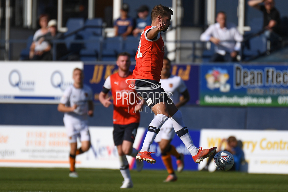 Luton Town midfielder Andrew Shinnie (11) looks to release the ball  during the EFL Sky Bet Championship match between Luton Town and Hull City at Kenilworth Road, Luton, England on 21 September 2019.