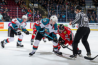 KELOWNA, BC - MARCH 02:  Kyle Topping #24 of the Kelowna Rockets faces off against Reece Newkirk #12 of the Portland Winterhawks  at Prospera Place on March 2, 2019 in Kelowna, Canada. (Photo by Marissa Baecker/Getty Images)