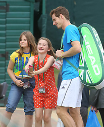 Image ©Licensed to i-Images Picture Agency. 29/06/2014. London, United Kingdom. Andy Murray  has a selfie taken with his twin cousins Ailsa and Cora Erskine during a training session at the Wimbledon Tennis Championships.   Picture by i-Images