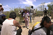 A six-year-old girl and her aunt, along with other illegal immigrants from Mexico, wait to be deported after they were apprehended by the U.S. Border Patrol east of Sells, Arizona on the Tohono O'odham Nation.  This area has the highest death rate of illegal border crossers in the nation.  The group walked for over two days in heat exceeding 110 degrees.  The girl was to have joined her mother who was living and working in New York.