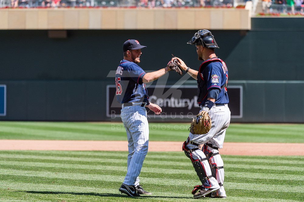 Minnesota Twins reliever Glen Perkins and catcher Ryan Doumit celebrate after the Twins beat the Cleveland Indians at Target Field in Minneapolis, Minnesota on July 29, 2012.  The Twins defeated the Indians 5 to 1.  © 2012 Ben Krause