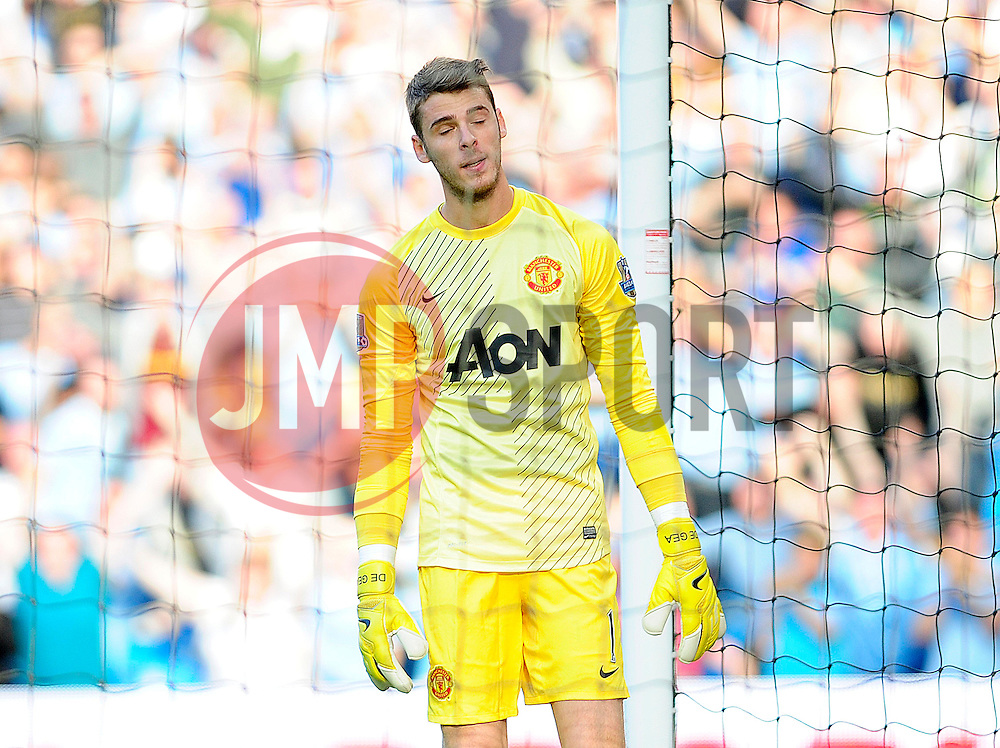 Manchester United's David De Gea cuts a dejected figure after Manchester City score - Photo mandatory by-line: Dougie Allward/JMP - Tel: Mobile: 07966 386802 22/09/2013 - SPORT - FOOTBALL - City of Manchester Stadium - Manchester - Manchester City V Manchester United - Barclays Premier League
